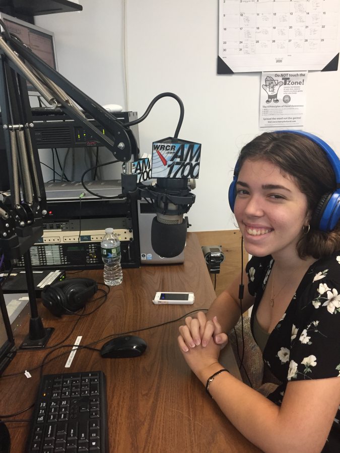 """Kathryn Cambrea poses in the WRCR station before co-hosting the """"John and Kat Show."""""""